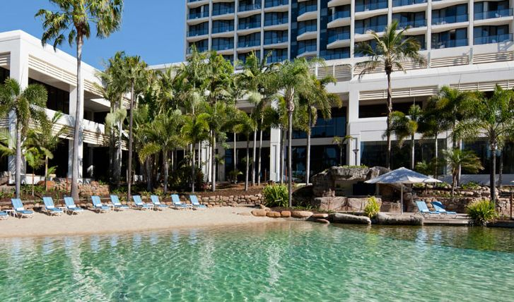 Marriott Surfers Paradise Lagoon Pool Beach lined with Beach Chairs and Palm Trees - Discover Queensland