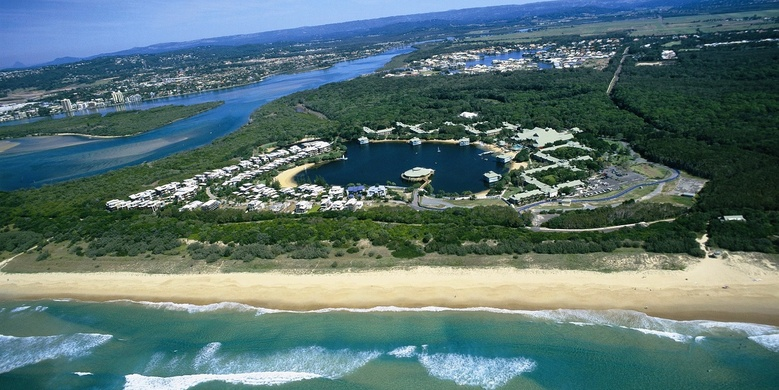 Birds eye view of Novotel Twin Waters Sunshine Coast, Queensland and surrounding forest, beaches, and river | Discover Queensland