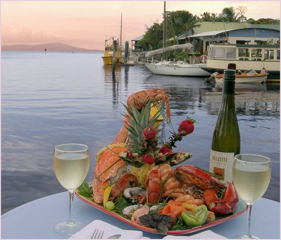 Seafood platter with wine and a view of the harbour at Port Douglas.
