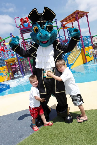 Kids hugging puppet pirate at the waterpark at Paradise Resort.