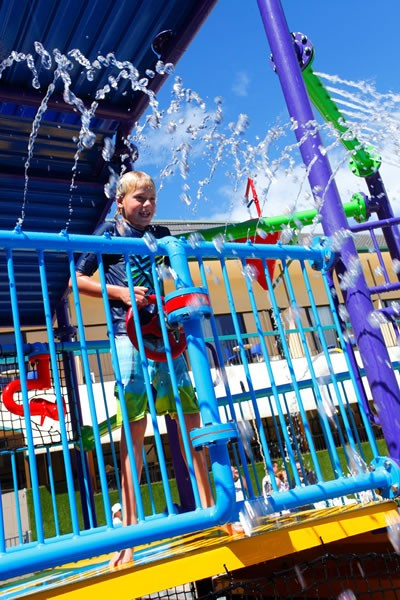 Little boy with water gun at Paradise Resort water park.