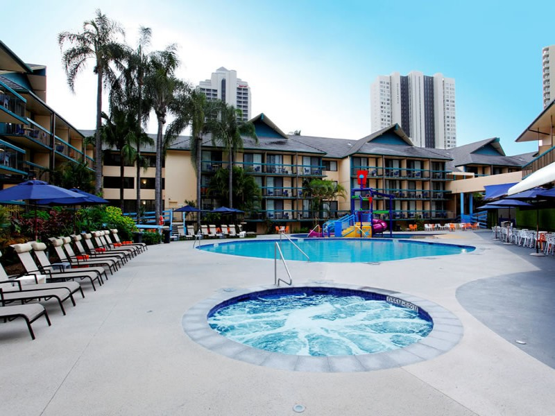 Pool and Spa area of Paradise Resort with Sun Chairs