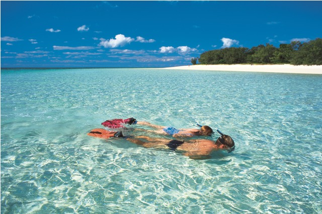 People Snorkelling on the Whitsundays in crystal clear waters.