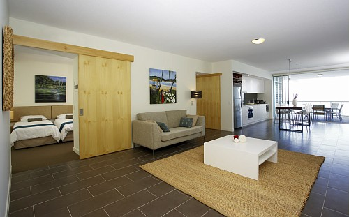 Grand Mercure Magnetic Island Apartment living area and bedroom.