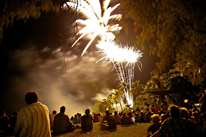 People in the park watching fireworks in Port Douglas.