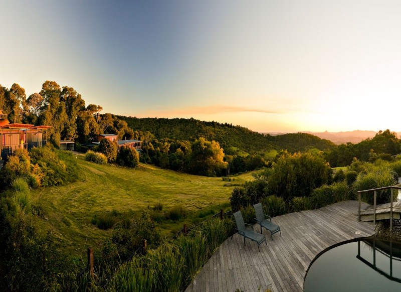 Sun setting over the private spa in a luxury villa at O'Reilly's Rainforest Retreat - Discover Queensland