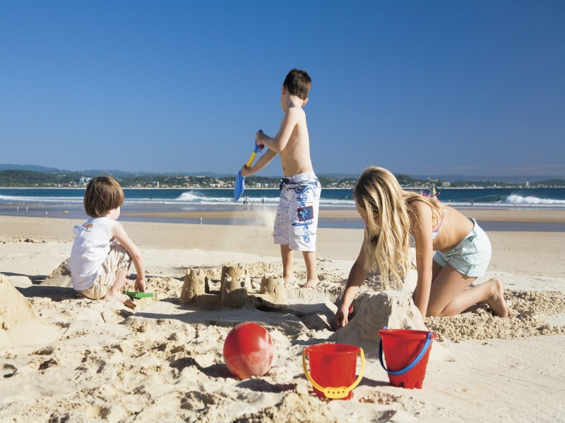 Kids Playing on the Beach outside of school holidays - Discover Queensland