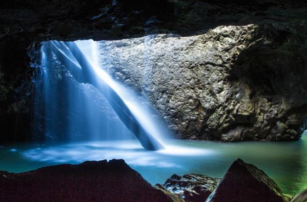 Natural Arch Waterfall in Springbrook National Park Gold Coast Hinterland - Discover Queensland