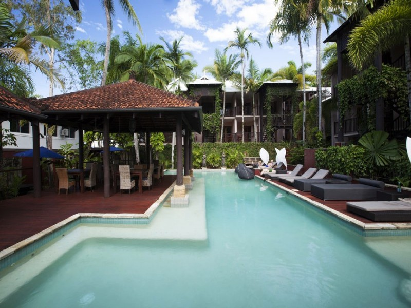 Hibiscus Resort & Spa Outdoor Pool with Deck Chairs in Port Douglas - Discover Queensland
