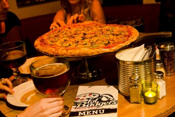 Delicious pizza's that are perfect for sharing at Fat Badgers Pizza - Queenstown Holidays