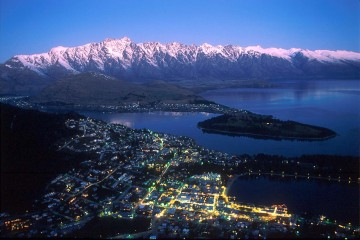 Queenstown at Night Flanked by The Remarkables Mountain Ranges - Queenstown Holidays