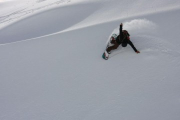 Snow Boarding from a Southern Lakes Heliski Drop - Queenstown Holidays