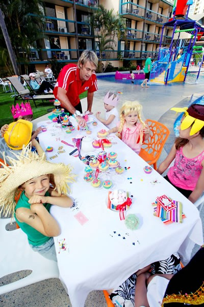 Kids enjoying an arts and crafts tea party at Paradise Resort, Surfers Paradise.