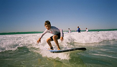 Take kids to Learn to Surf classes on the Gold Coast
