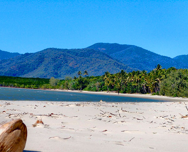 Tropical North Queensland Beach with views of Mountain ranges.