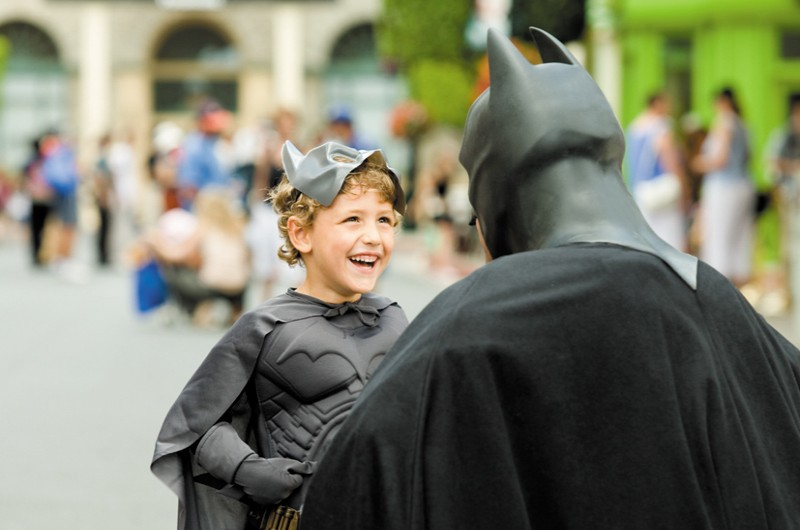 Child Meeting Batman at Movie World
