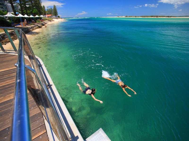 Couple Snorkeling the Caloundra Coastline - Hightide Holidays