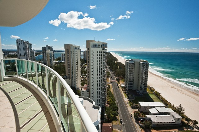 Private balcony with panoramic views of the beach. Ocean Pacific Resort - Hightide Holidays