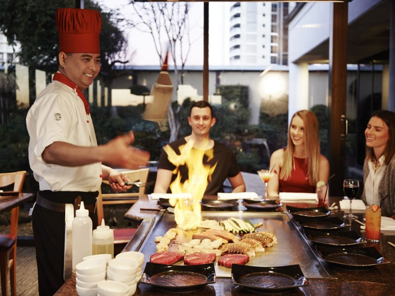 Misono Japanese Steakhouse Chefs performing for guests - Hightide Holidays