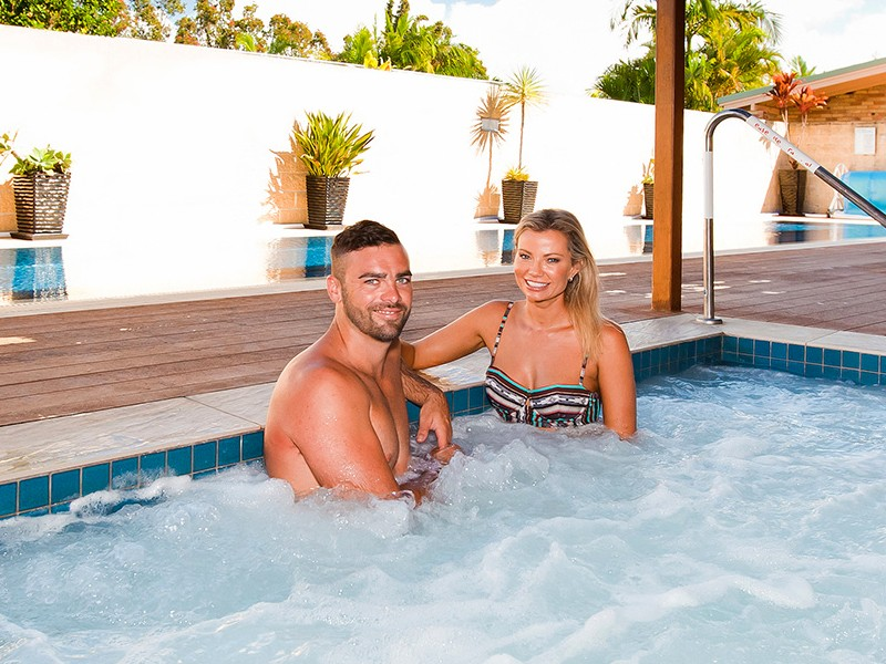 Mum and Dad relaxing at Seascape Leisure Centre Spas at North Star Holiday Resort | Things to do at Hastings Point | Discover New South Wales