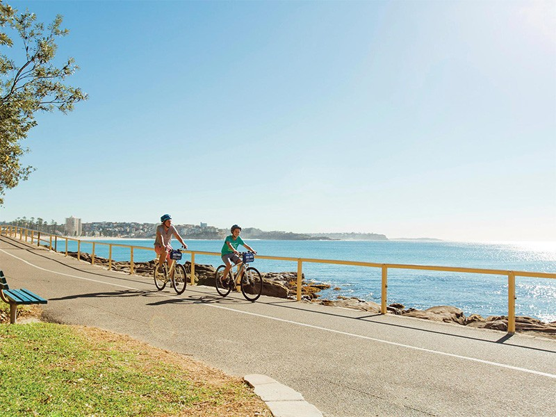 Bike Riding along Manly Beach - Image Via Destination NSW