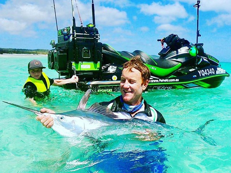 Trev from Team fishski with a catch | Image by @fishskiaustralia via Instagram | 15 Photos That Will Make You Want to Visit Fraser Island | Discover Queensland
