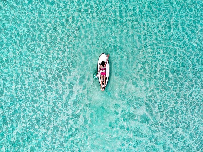Paddle Boarding in Paradise | Image by @keeping.up.with.the.joneses_ via Instagram | 15 Photos That Will Make You Want to Visit Fraser Island | Discover Queensland