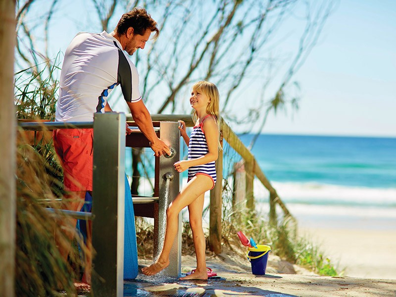 Family on the Beach at Broadbeach | Breakfree Diamond Beach: Location, Location, Location! | Discover Queensland