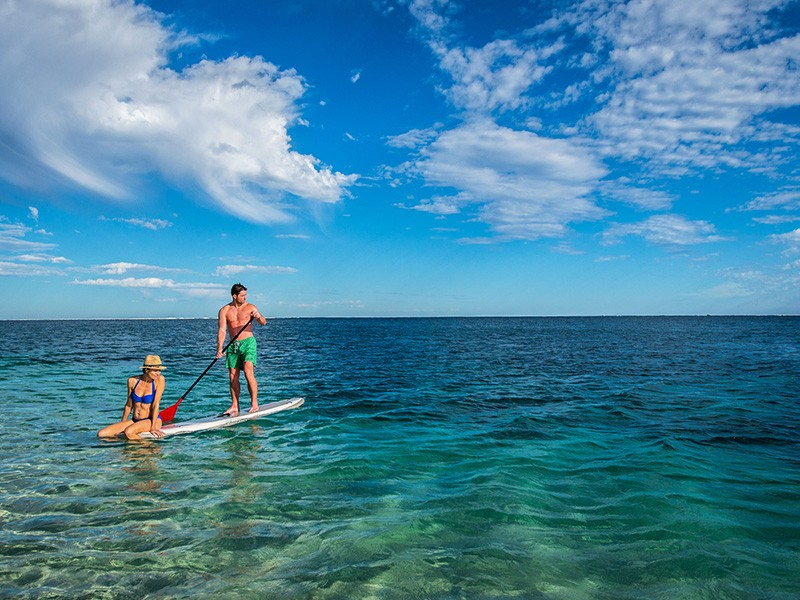 Stand Up Paddle Boarding in Coral Bay | Image via Tourism Western Australia | 7 Ways to Enjoy the Water in Exmouth | Discover Western Australia