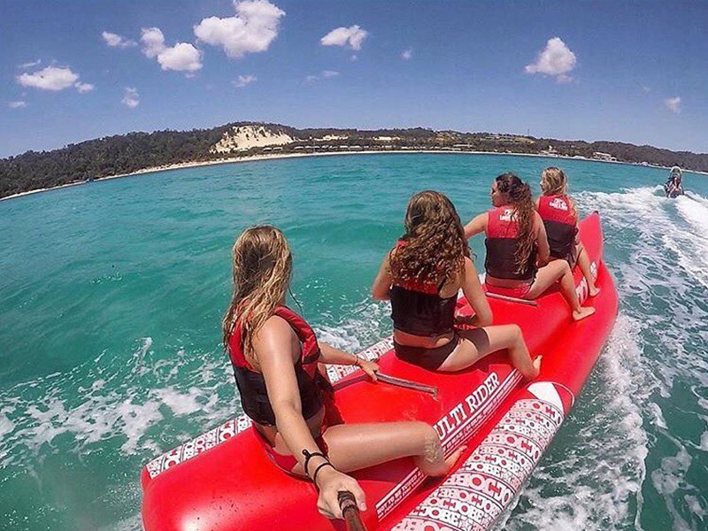 Tube Riding | Image by @emmabirbaud | Top 30 Things to do at Tangalooma Island Resort on Moreton Island | Discover Queensland