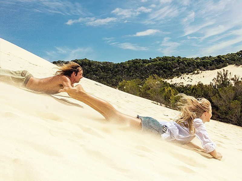 Sand Tobogganing | Top 30 Things to do at Tangalooma Island Resort on Moreton Island | Discover Queensland