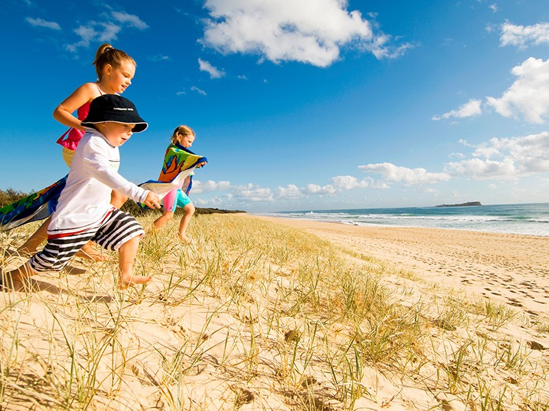 Kids playing at Mujimba Beach across from Sebel Twin Waters | Discover Queensland
