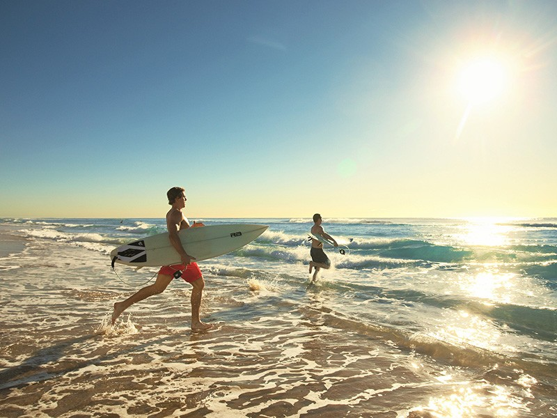 Surfing at Main Beach | Bromance Escapes: A Gold Coast Boys Weekend Itinerary