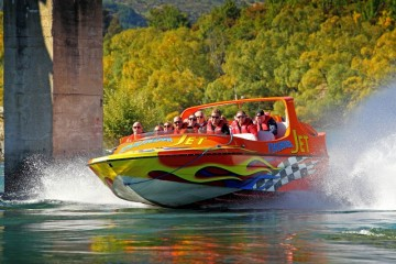 Thunder Jet Boat Speeding down the river - Queenstown Holidays