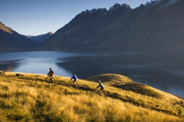 Jacks Point cycling in evening light - Queenstown Holidays